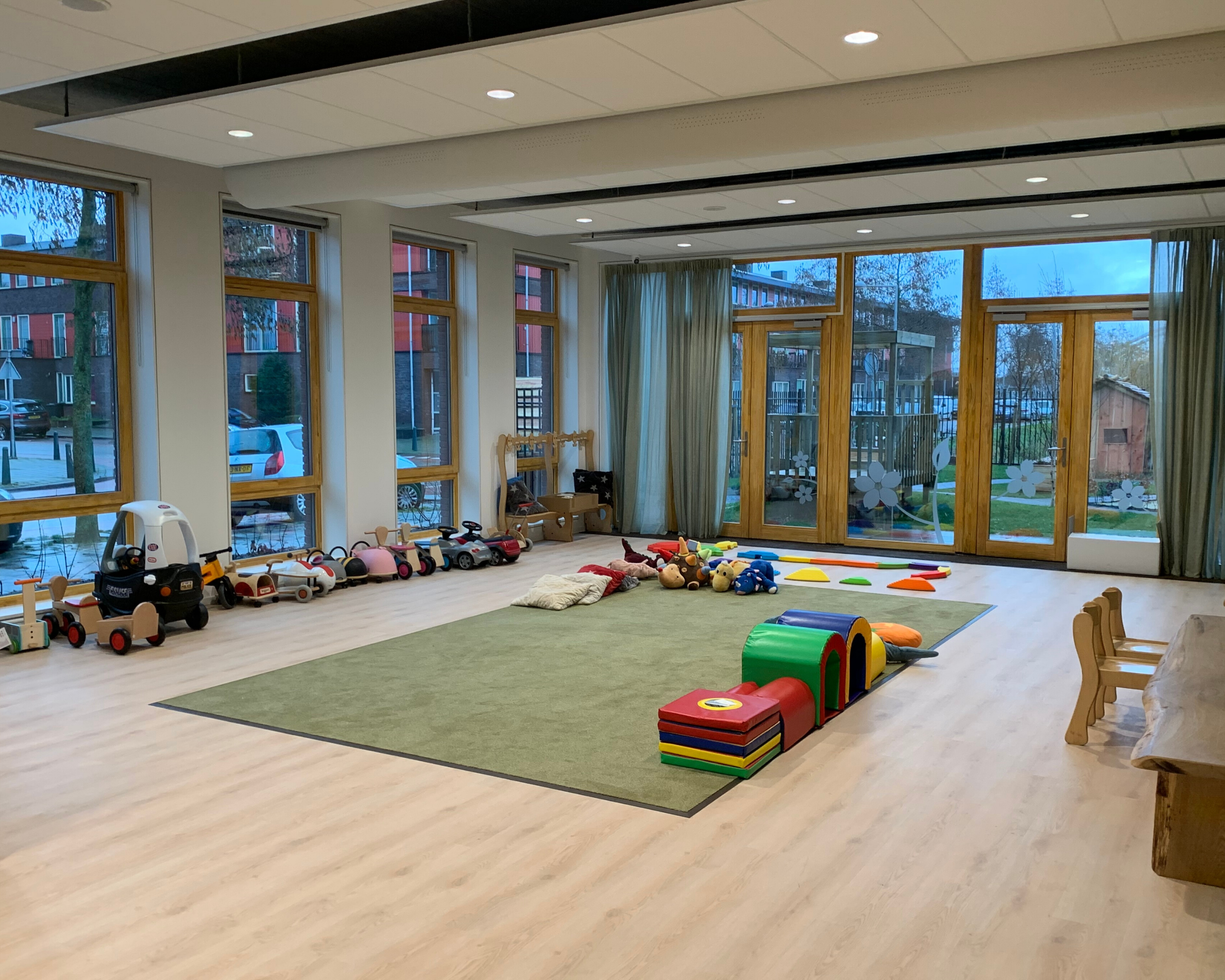 Children's toys and play area in day care hall.
