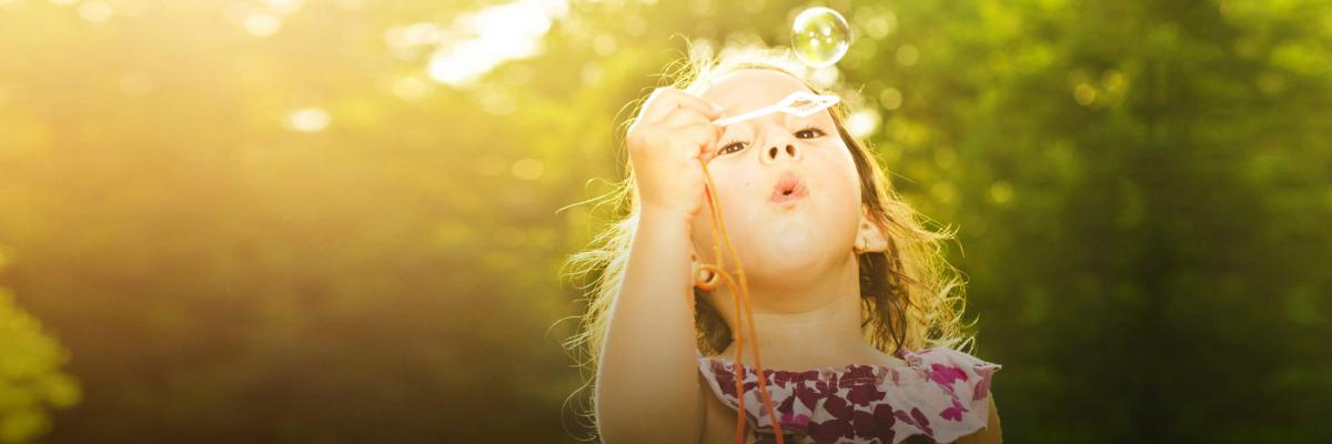 Student blowing bubbles.
